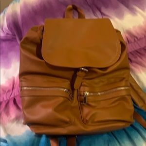 Camel colored backpack
